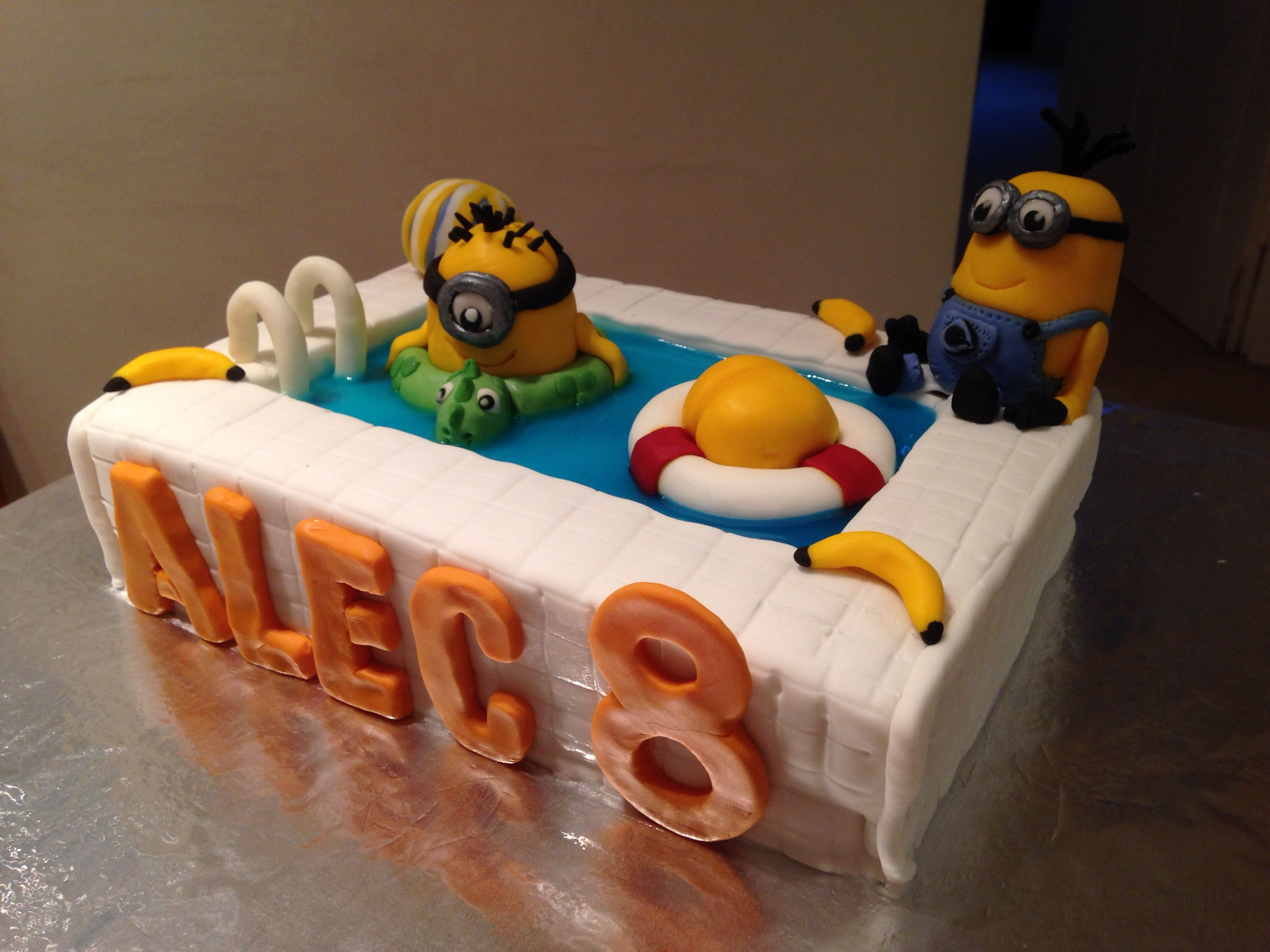 Minion pool cake with Kevin Fondant and blue gel covering a