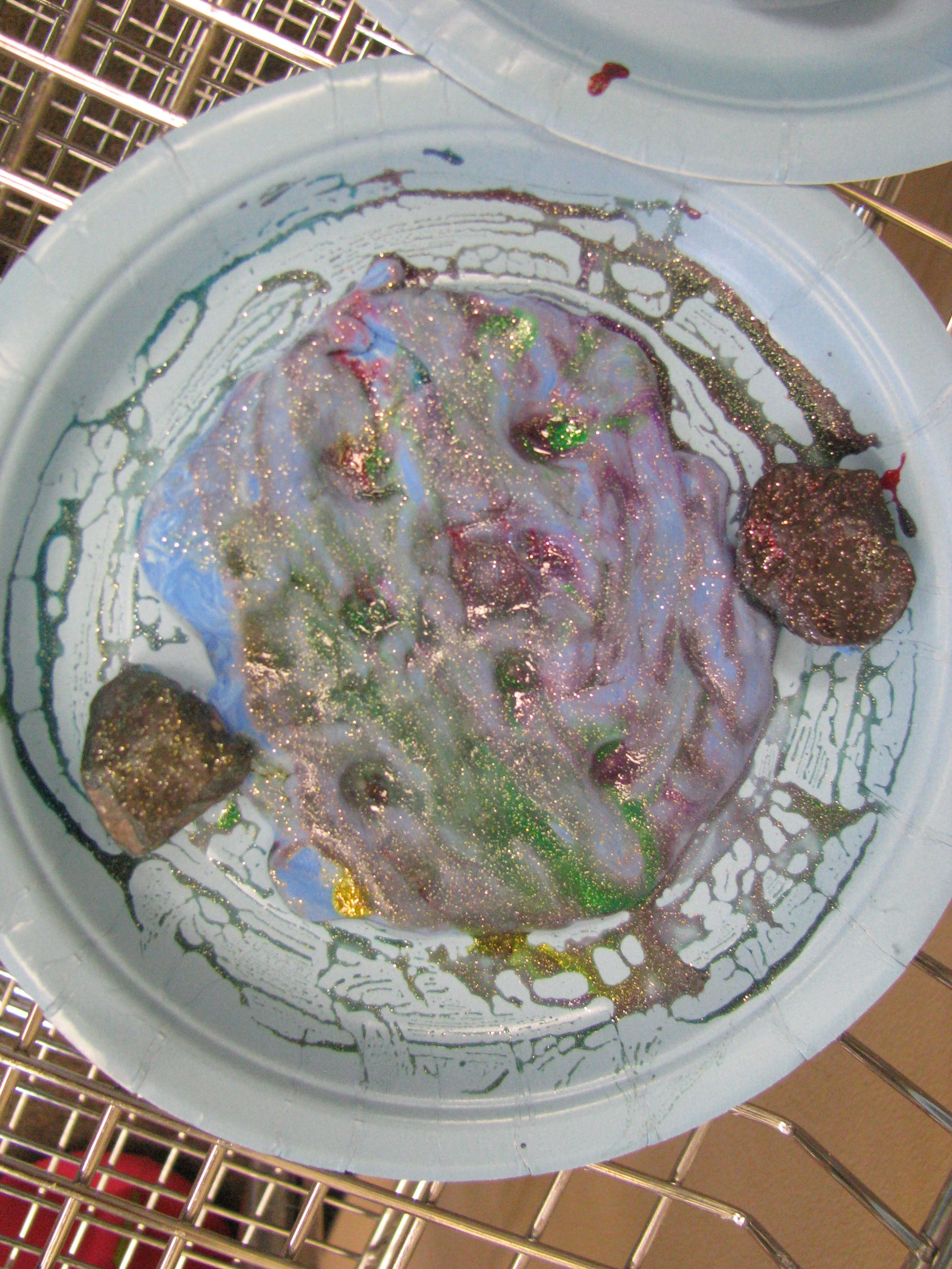 """moonscape with model magic, glitter paint and rocks that we found going on a """"moon rock hunt"""""""