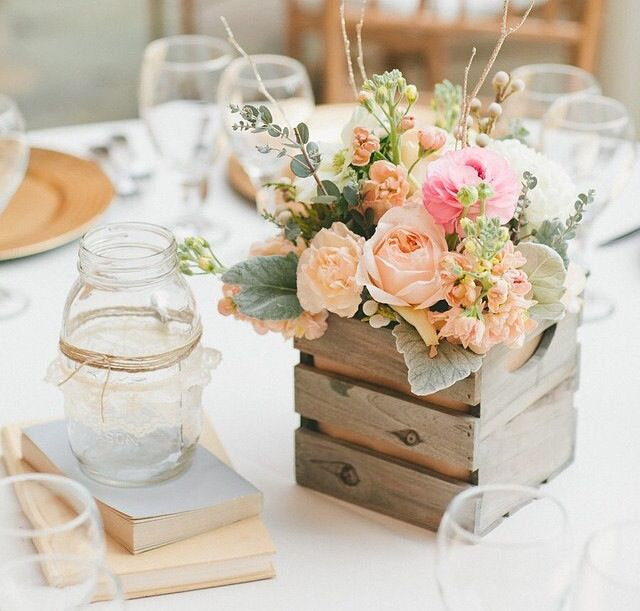 Love this adorable rustic centerpiece with a mini crate and peachy florals.