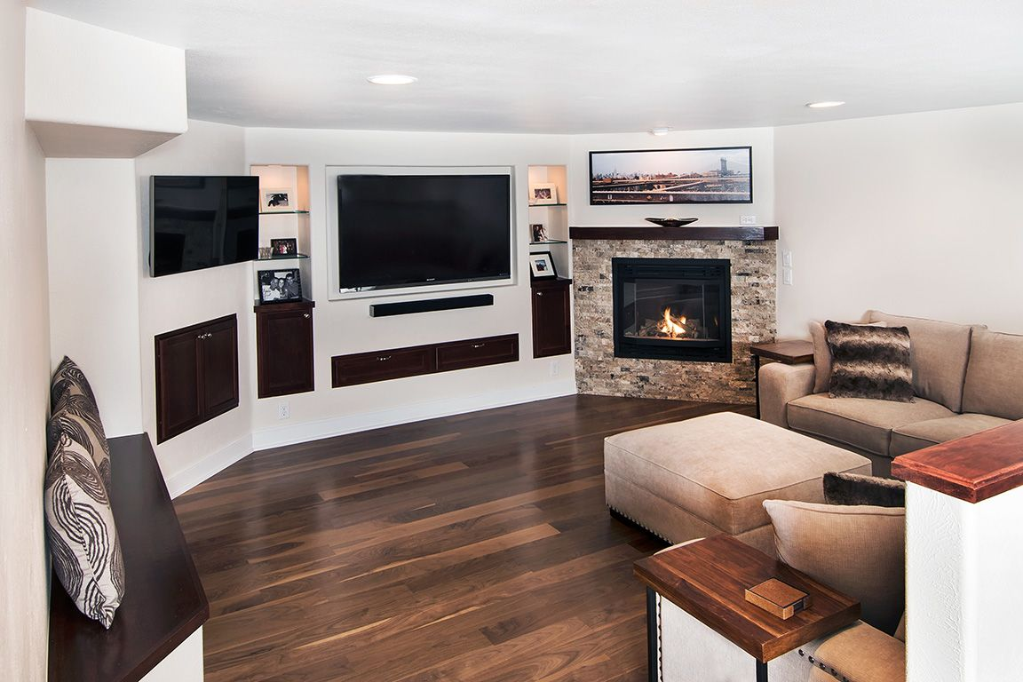 Basement With Built In Media Center With Recessed Columns Stone Corner Fireplace And Two Televisions Basement Remodeling Remodel Master Bathroom