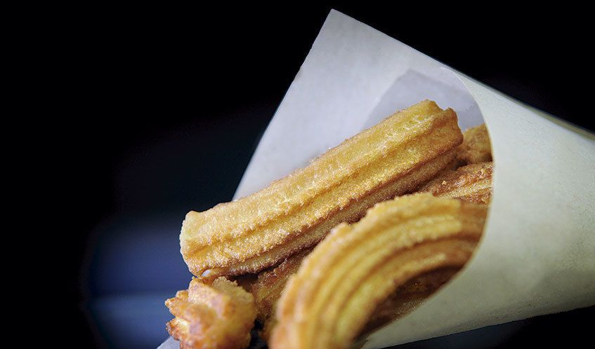 Discover the top 10 places in Barcelona to find delicious churros with chocolate.