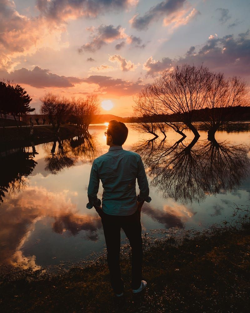 A Man Watching The Perfect Sunset By The Lake By Gokhan Altuntas Landscape Lake Portrait Sunset Photography People Lake Photoshoot Sunset Photography