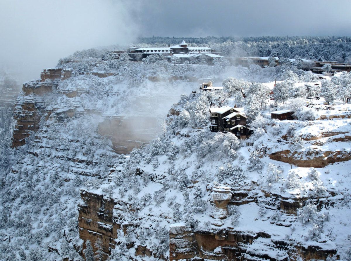 Winter At The Grand Canyon Village With El Tovar Hotel At The Top - Rare weather event fills grand canyon with fog and gives us this breathtaking sight