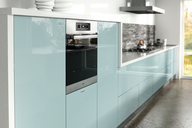 Light blue gloss kitchen in a modern & uncluttered slab style.