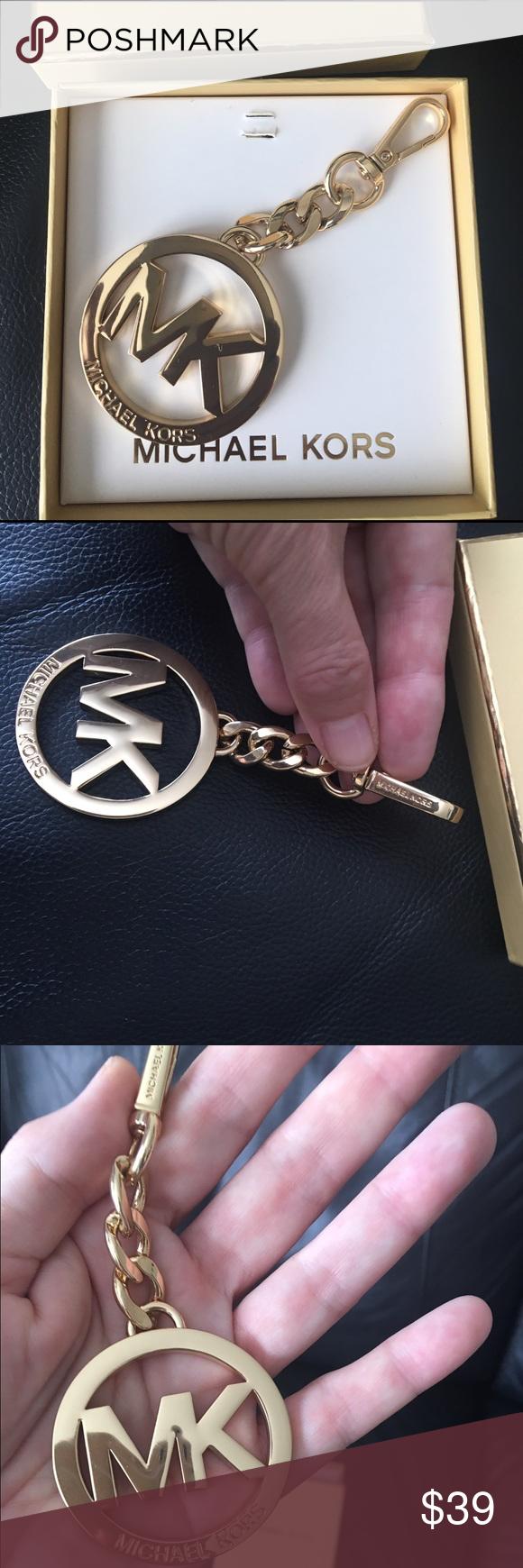 New Michael Kors Large Logo Key Chain/ Bag Charm New Authentic Michael Kors Large Golden Logo KeyChain/ Bag Charm. Come with box Michael Kors Accessories Key & Card Holders