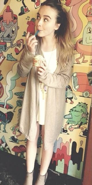 Sabrina Carpenter eating ice cream.