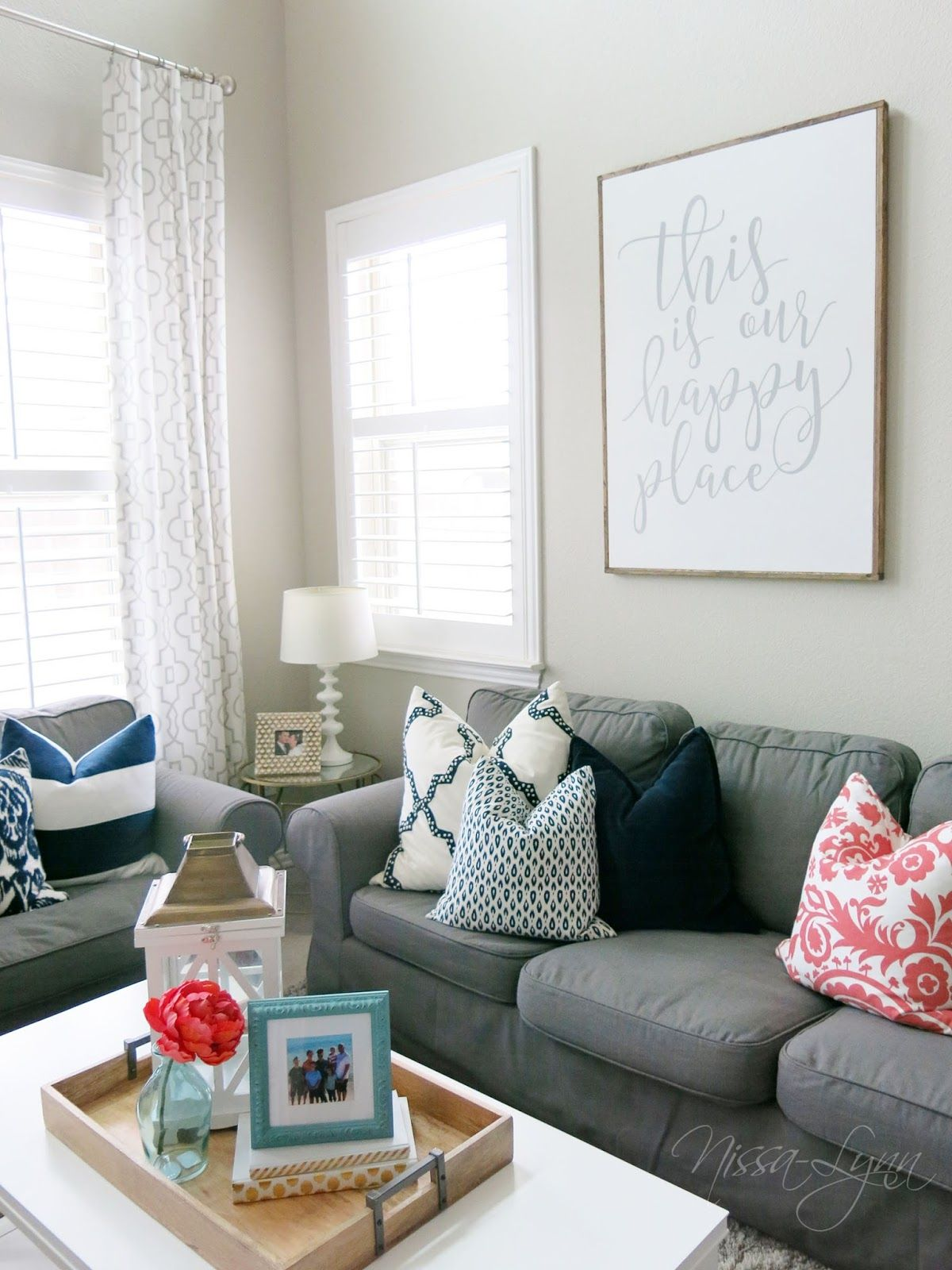 A fresh living room with pops of colors- navy, aqua gray and coral ...