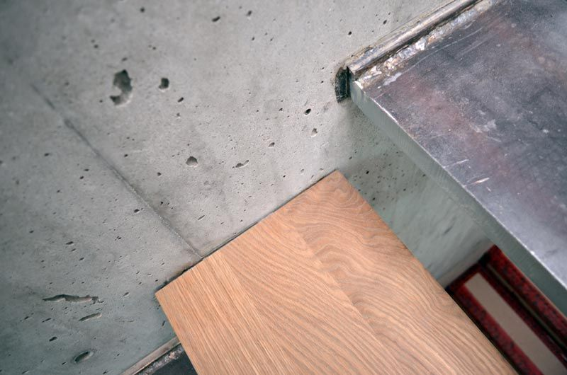 Steel cantilevered steps attached to concrete wall wood How to finish a concrete wall