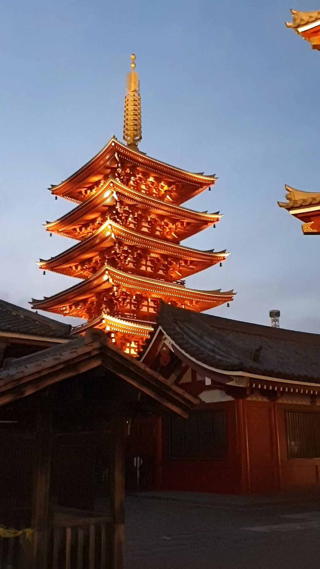 This is Senso-ji Temple in Asakusa, Tokyo. It's equally impressive by day or night. Click to find out how to experience traditional culture in Tokyo on the blog, including the difference between a shrine and a temple.
