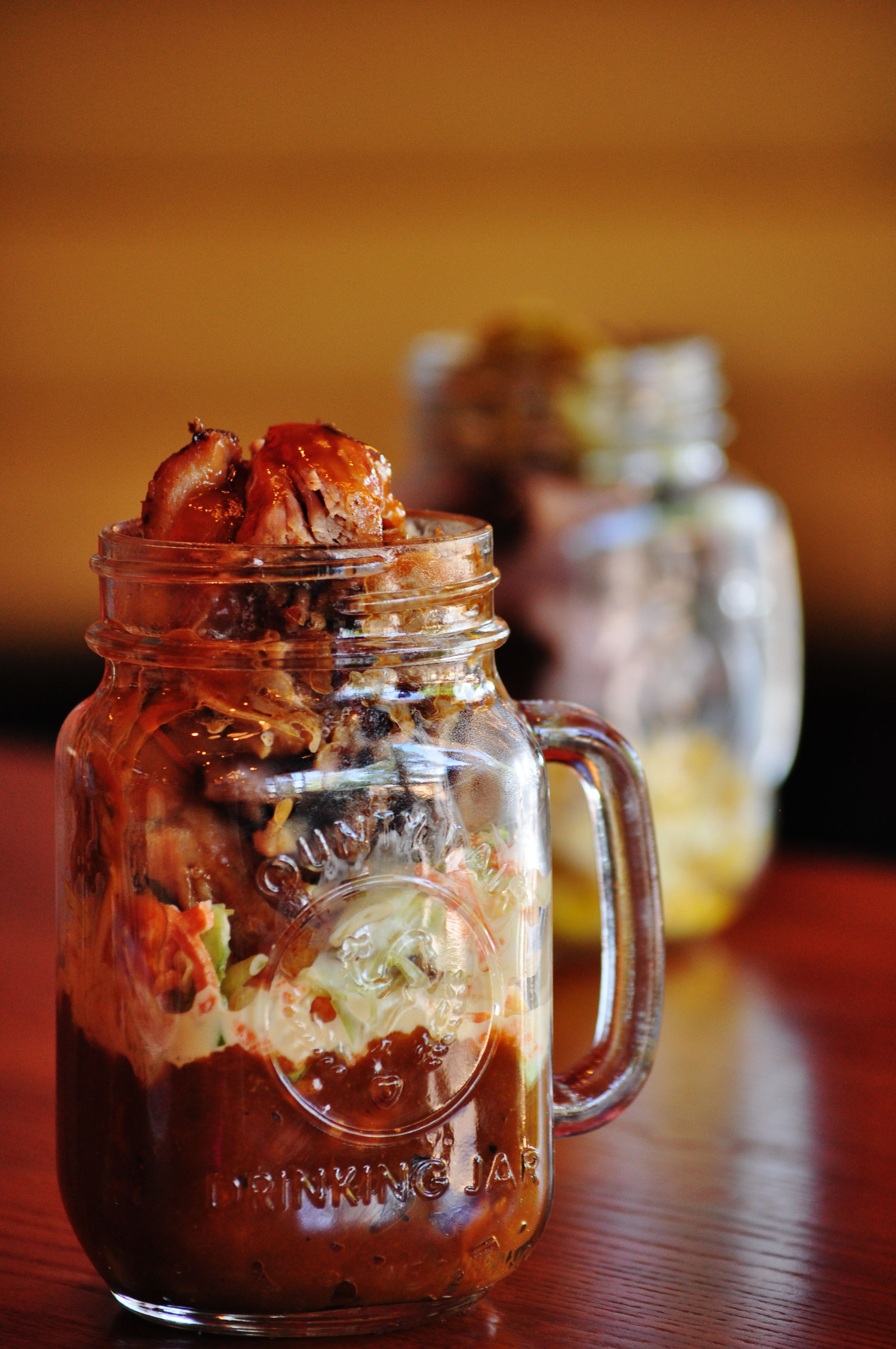 Featured On The Food Network The Que Stacked Mason Jar Pulled Pork Southern Slaw Bbq Baked Beans At Ten Park Lanes Yup Good Food At The Bowling