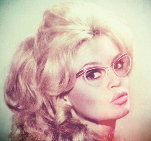 Brigitte Bardot. I need to know who made these glasses.