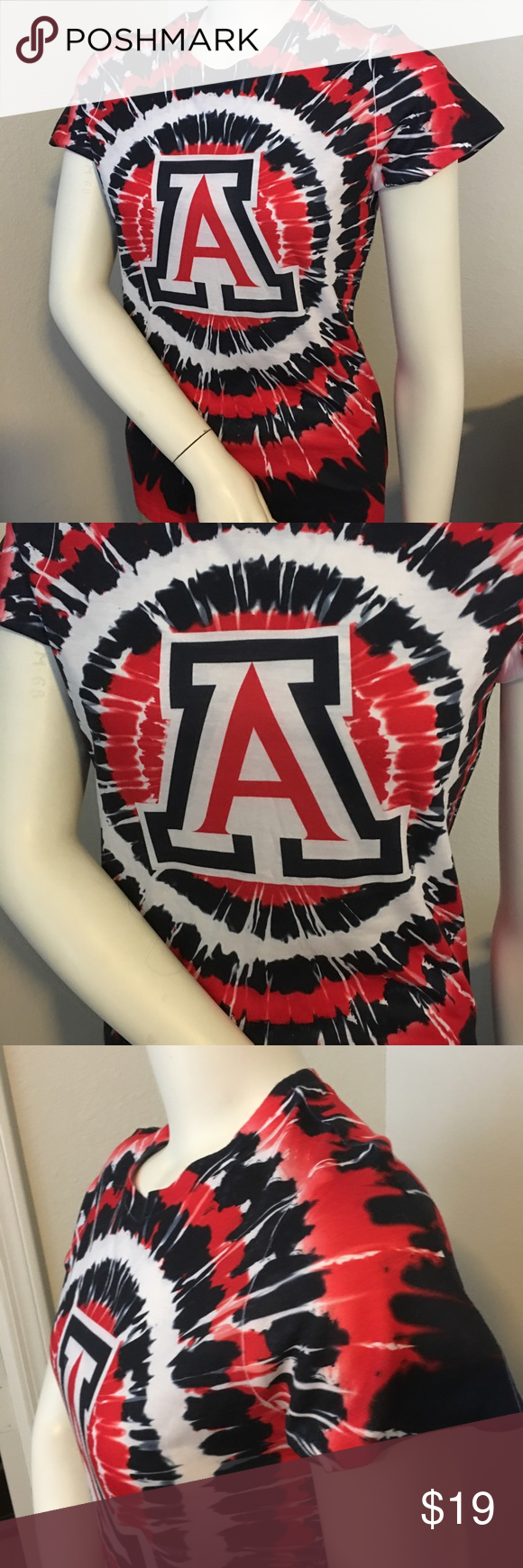 """NCAA Arizona Wildcats tie-dye womens shirt sz: M Thank you for viewing my listing, for sale is a women's, short sleeve, university of Arizona Wildcats, red white and blue, short sleeve graphic T-shirt. T-shirt is tie-dye.  If you have any questions or would like additional photos please feel free to ask.   Sz: M  From under one arm to under the other measures appx 17"""" from the top of the shoulder to the bottom of the shirt measures appx 26"""" Tops Tees - Short Sleeve"""
