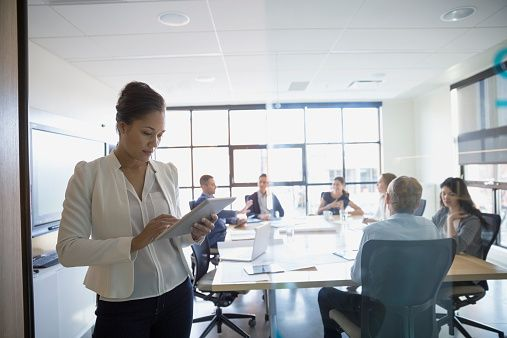Stock Photo : Businesswoman with digital tablet in conference room meeting