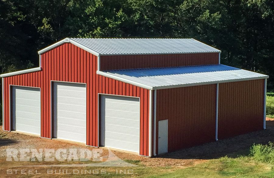 Red Barn Style Clear Span Metal Building With White Trim And Large White Roll Up Doors Renegade Stee Steel Buildings Pre Engineered Buildings Metal Buildings