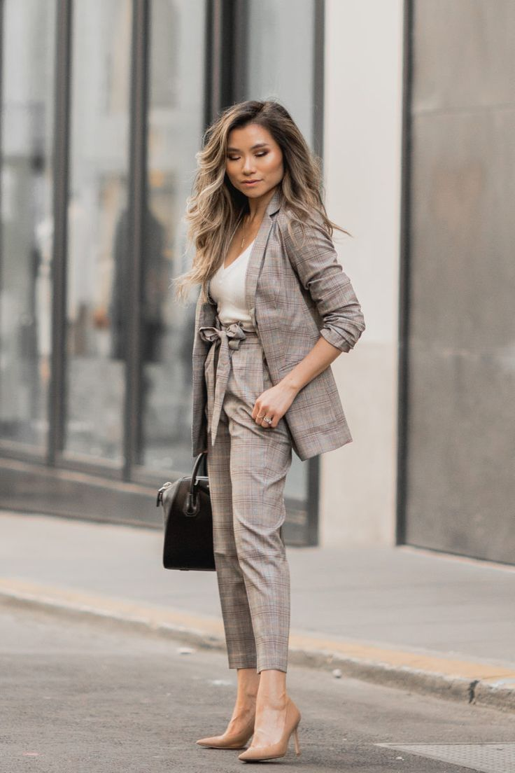 Fashion Blogger Miss Louie wearing fall work outfit with express blazer and pants with Givenchy Smal