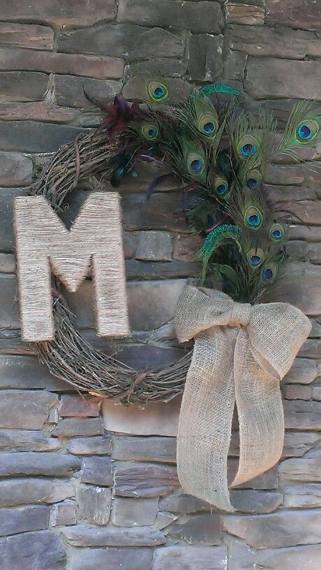 My new peacock wreath by Pam Etheridge....I made the M :)