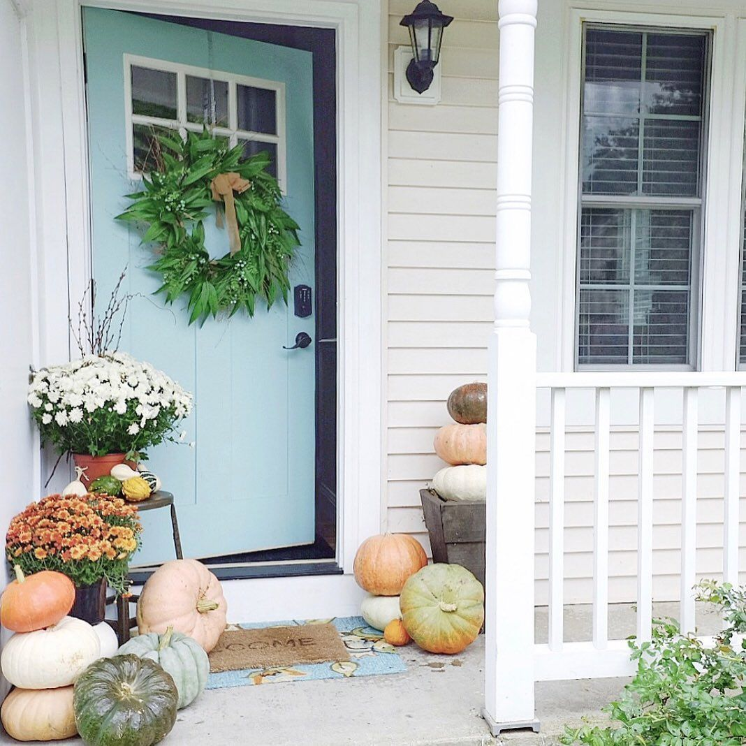 Sometimes I think about changing the color of the door over at the cottage Airbnb. I wonder if navy would look pretty or maybe even a sage green? Or maybe even something wild and crazy like fushia! Hmmm....???? . . What color would you do? Send your ideas my way!! . . #pumpkins #frontporch #moveitupmonday #frontdoor #ouruptowncottage #falldecor #thedesigntwinslovefall #makehomeyours #mums #curbappeal #happyfallyall #designtrends #cottagestyle #cottagesandbungalows #bhgholiday #falldecorideasfort