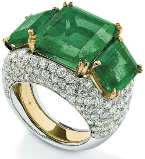 An emerald and diamond ring. Designed as a centrally-set cut-cornered rectangular-cut emerald between similarly cut emerald shoulders with removable pavé-set diamond jacket, ring size N, emeralds weighing approximately 15 carats. Via Phillips.