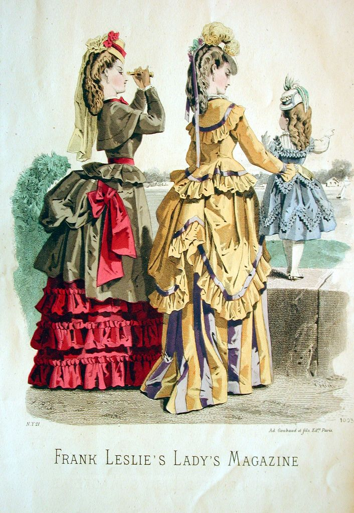 1874 fashion print Ladies Magazine - love the yellow & purple (could be blue) combination, and all the ruffles on it, hats tilted forward w/ ribbons or lace hanging in back