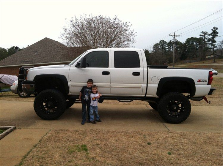 jacked up white chevy trucks - photo #18