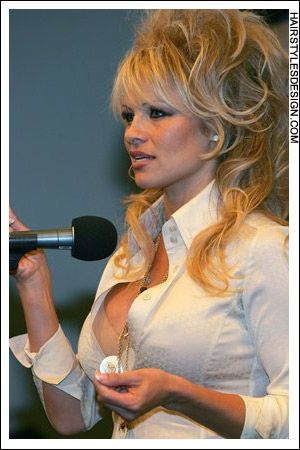 Details: Hair Style: Pamela Anderson has her hair built up very ...