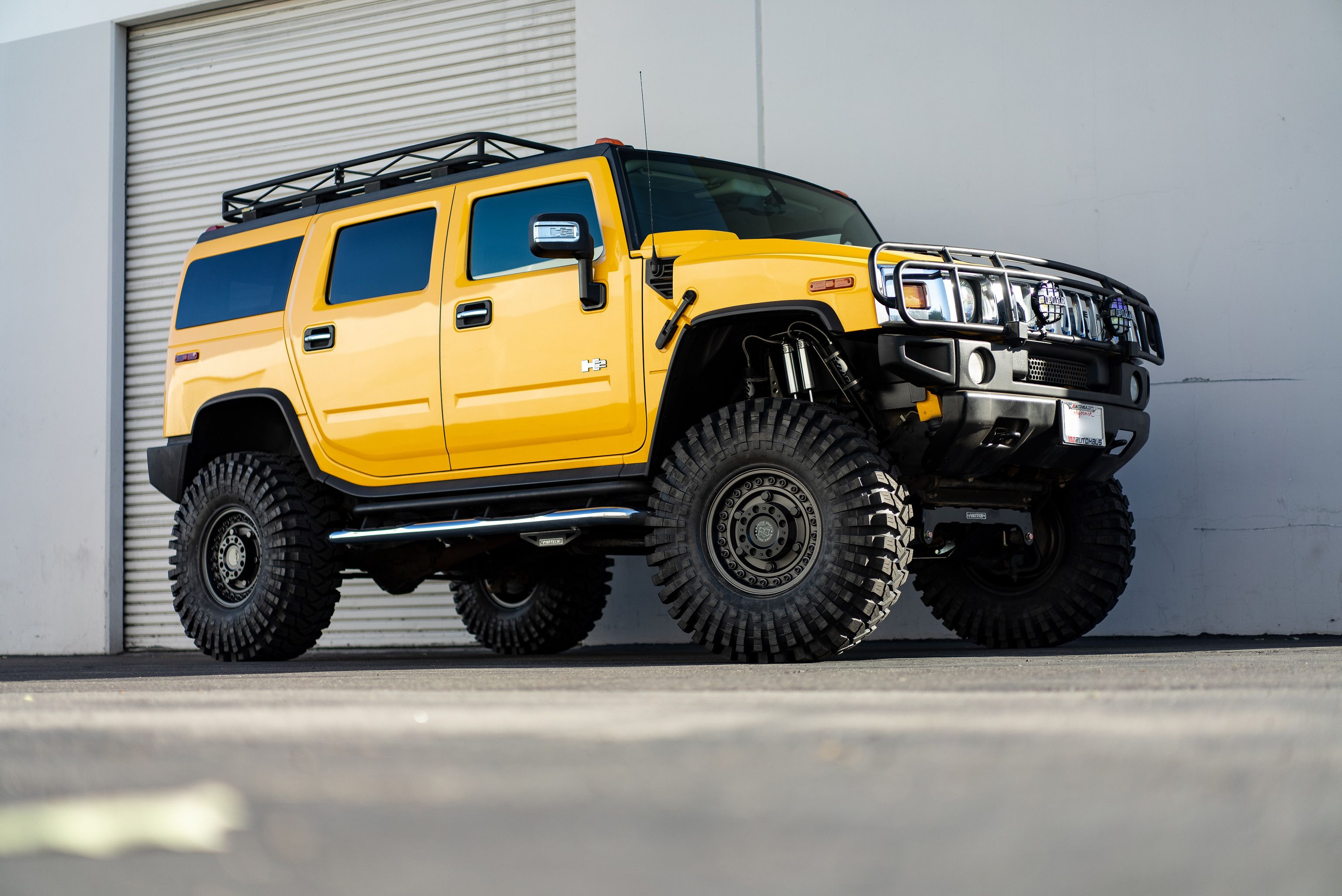 Yellow Lifted Hummer H2 On Black Rhino Armory Gunblack Gunmetal Military 17 Inch Off Road Wheels 89 Hummer H2 Hummer Monster Trucks