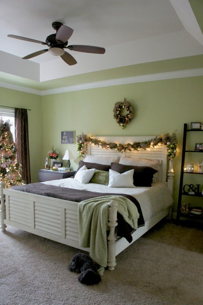 Bed decorated with Christmas garland. More Christmas decor
