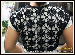 I used international symbol with step-by-step instructions. For free crocheted pattern of this bolero please click here.
