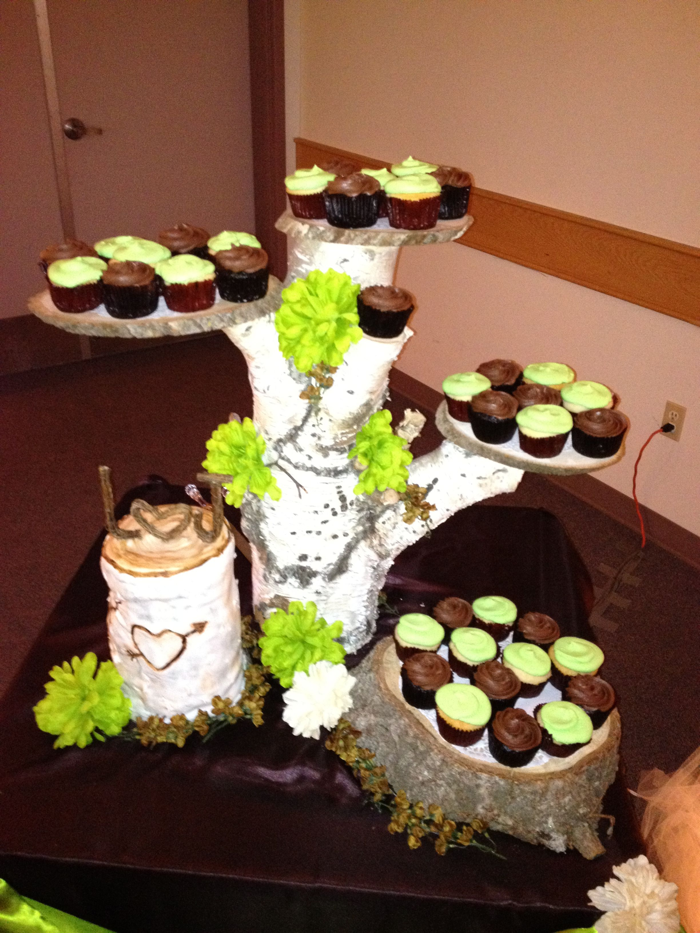 Wooden cake stand w cupcakes. Plus the log w heart design