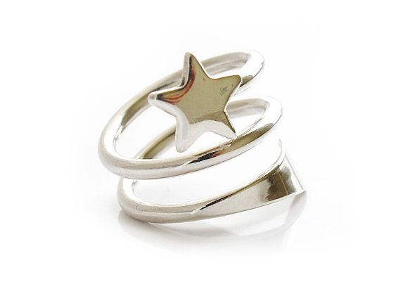 """Shooting Star - Sterling Silver Ring """"Shooting Star"""" is a ring for women like you. In form of a shooting star. Feel free by wearing this wonderful and young ring. We find this ring to be lovely and cute. It has a smooth finish and a very soft feel. Wonderful."""