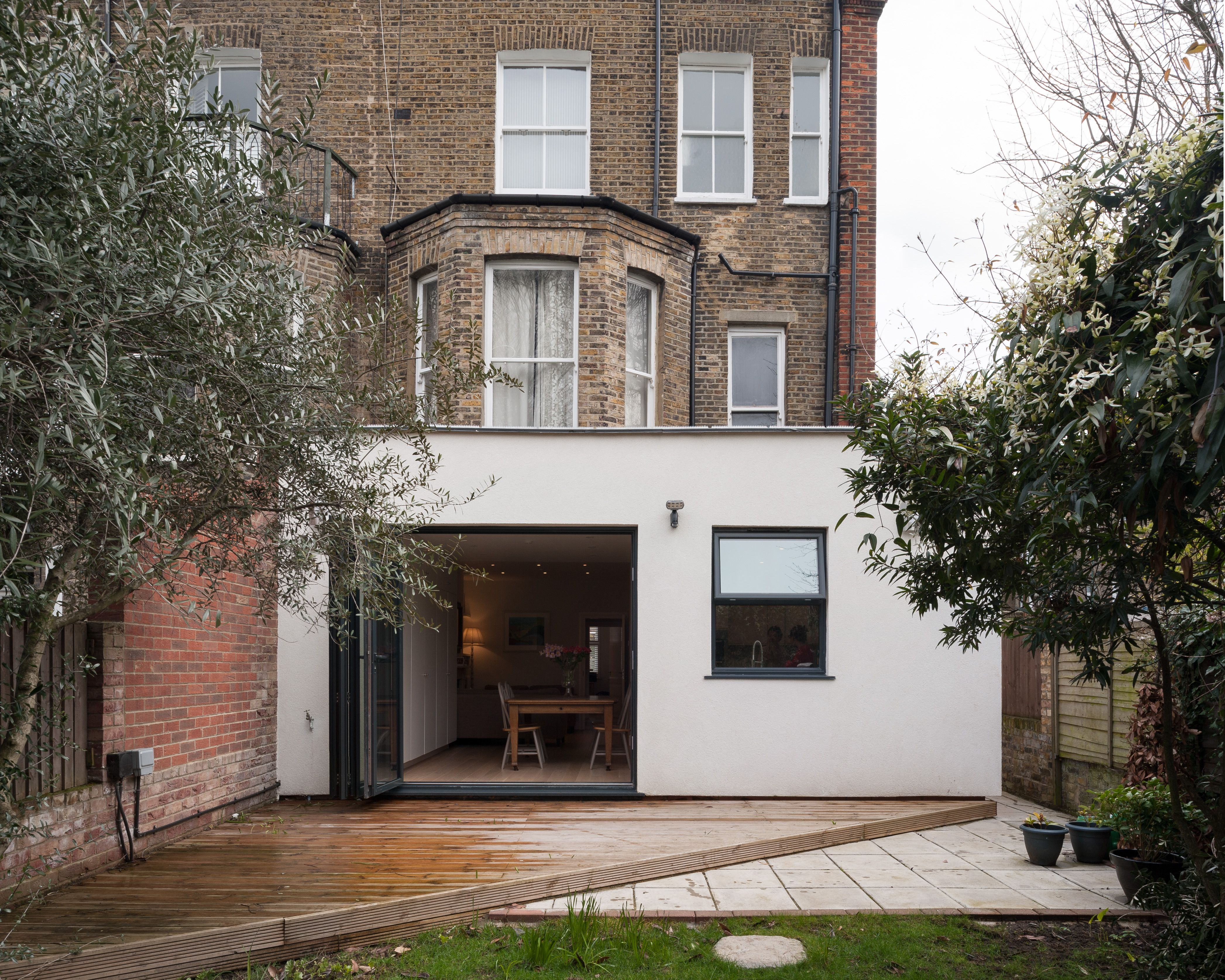 Modern contemporary rear extension on north west london for Terrace house opening new doors