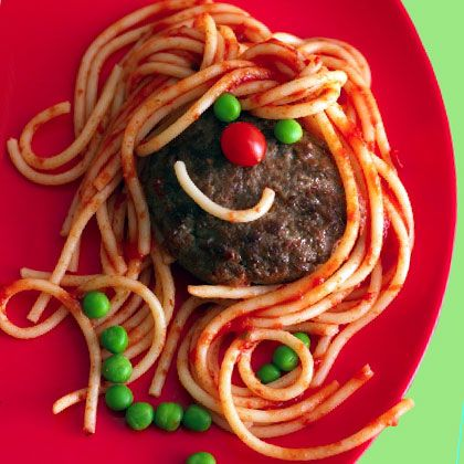 Use lean ground beef or ground turkey for these healthy smiling burgers, topped with nutritious tomatoes and peas.