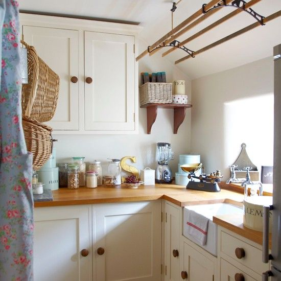 Cream Country Style Kitchen This Cottage Utility Room Has Classic Cream Kitchen Cupboards A Butler Sink And Space Saving Sheila Maid Airer