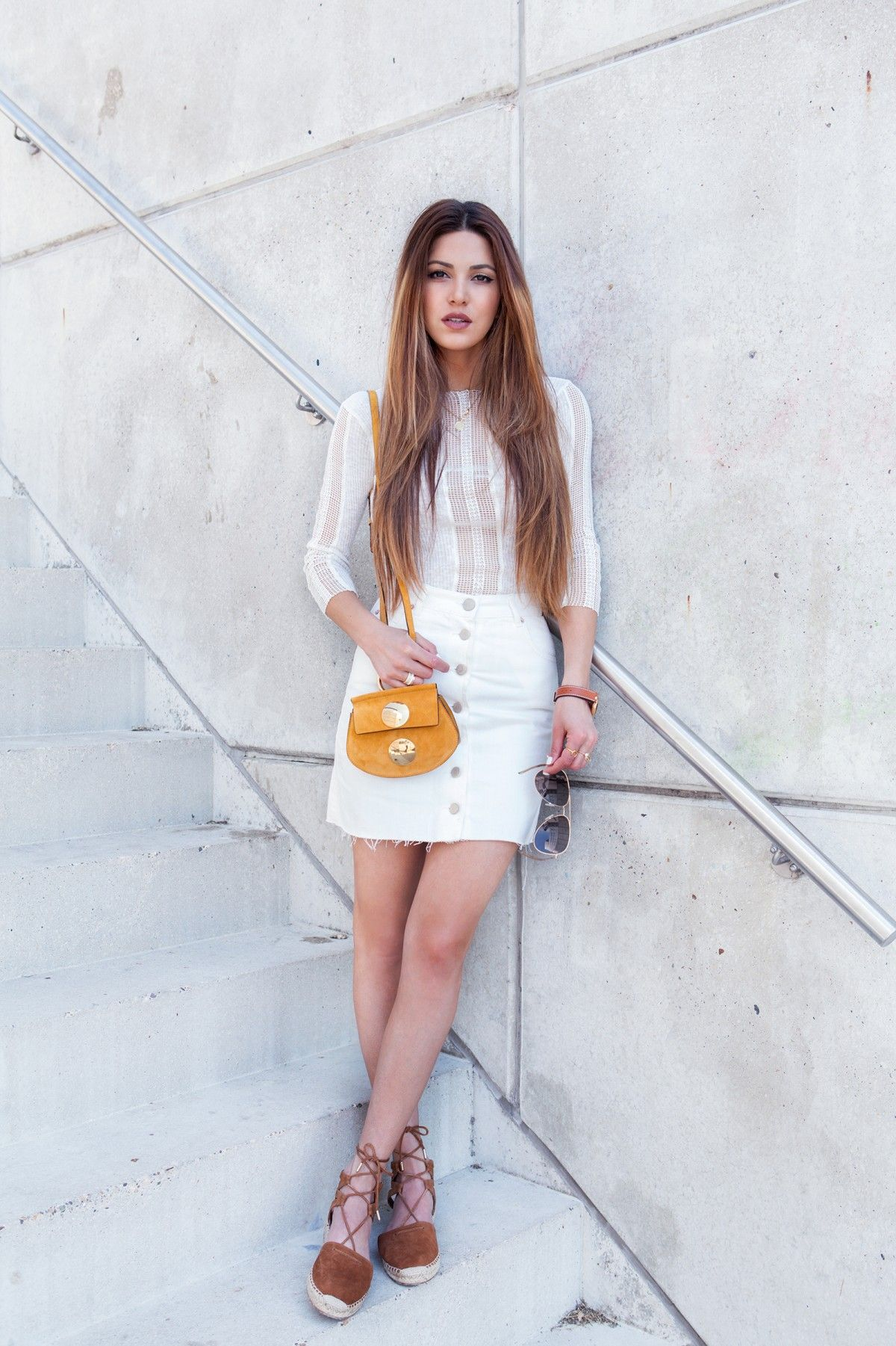 All white outfit with a cotton and lace top combined with a white button  front denim skirt and suede espadrilles. Via Negin Mirsalehi Top  Maje a622606fb40