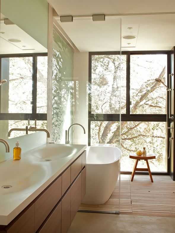 Bathroom with big windows at Sycamore House in Pacific Palisades, California by the Kovac Architects