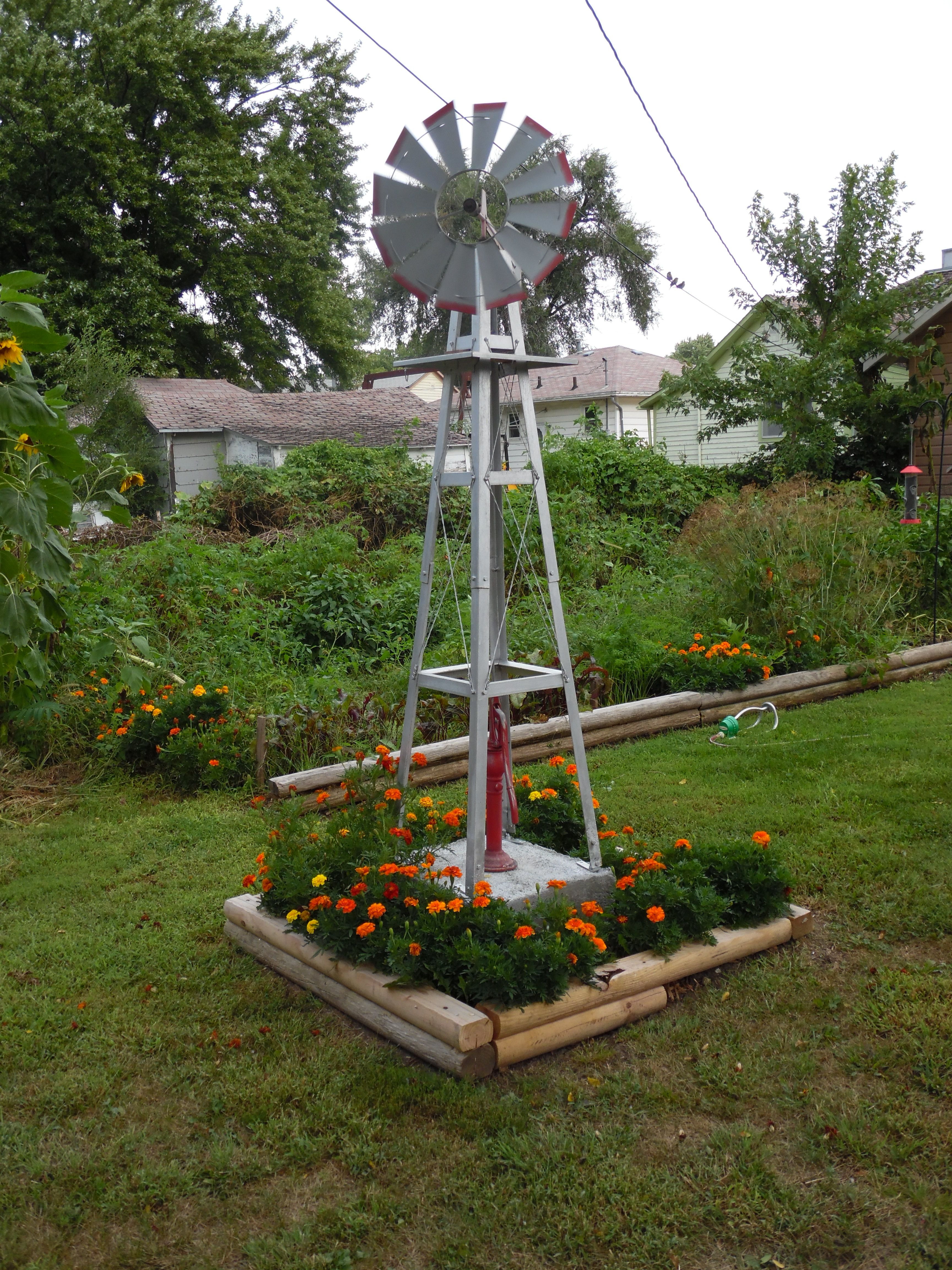 Our Windmill With Images Garden Pots Front Yard Yard Decor