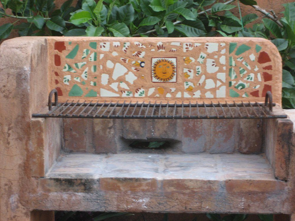 Mexican Tile Mosaic In An Outdoors Fireplace, Mexican Home Decor