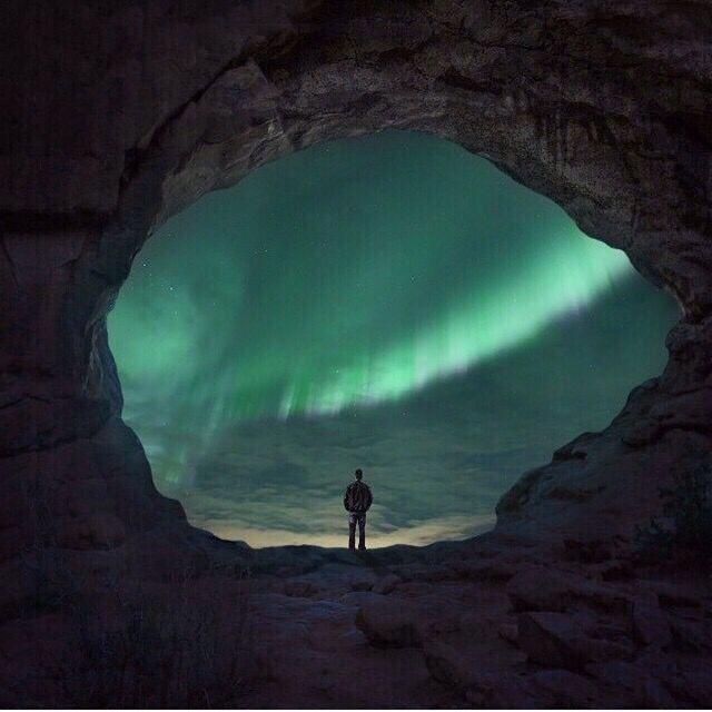 northern lights through cave
