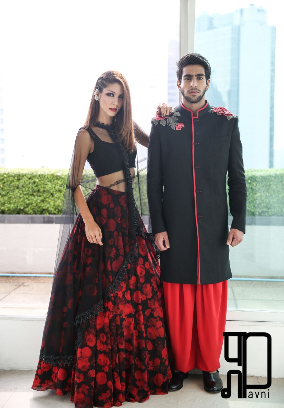 7d5056500dd35 On her  Flower-print lehenga with black leather crop top and a cape instead  of a dupatta. On him  Linen sherwani with rose embroidery at the shoulders