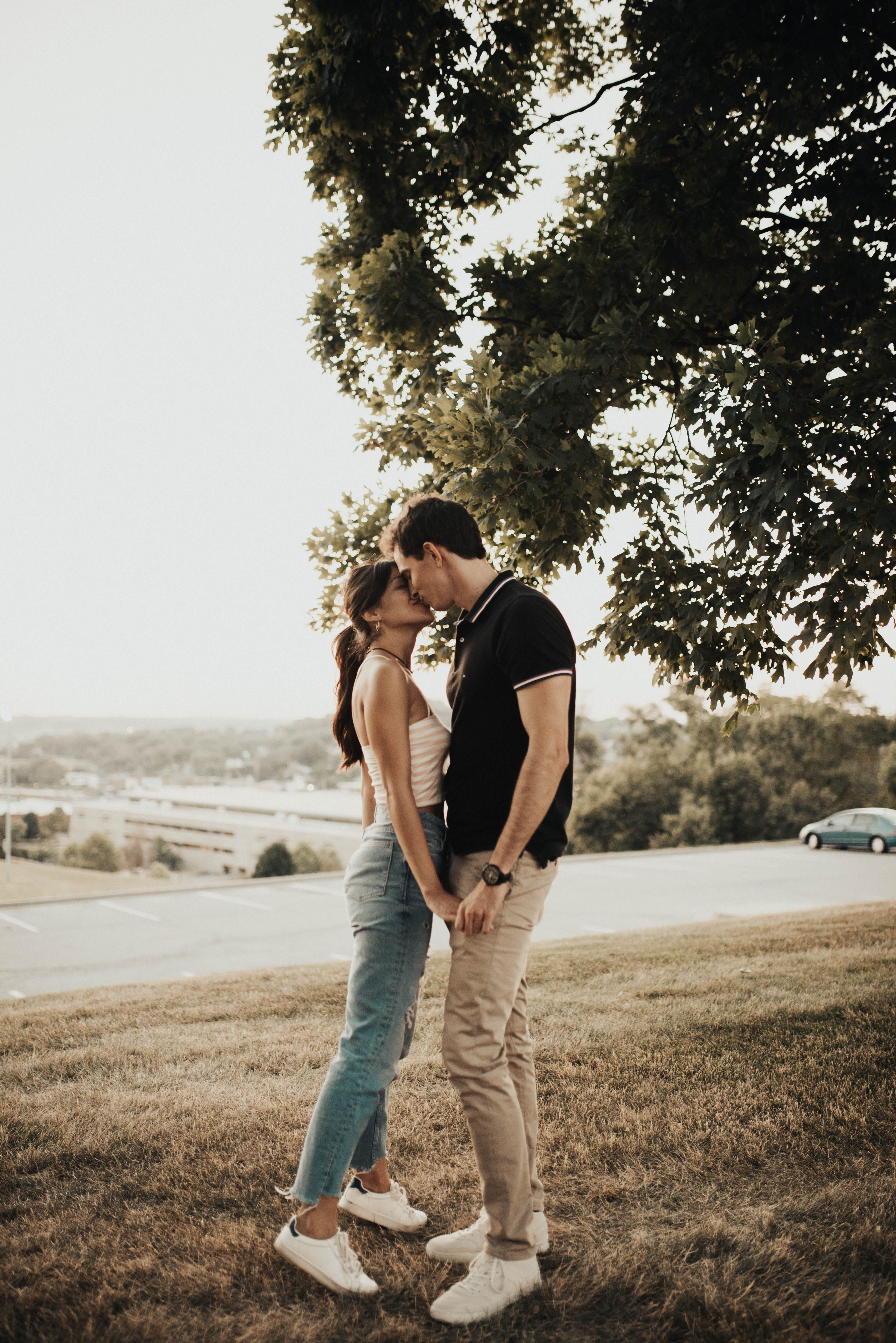 Cute And Warm Couple Session Romantic Engagement Session In Field Casual Outfits For Engage Couple Photography Poses Cute Couple Pictures Cute Couples Photos