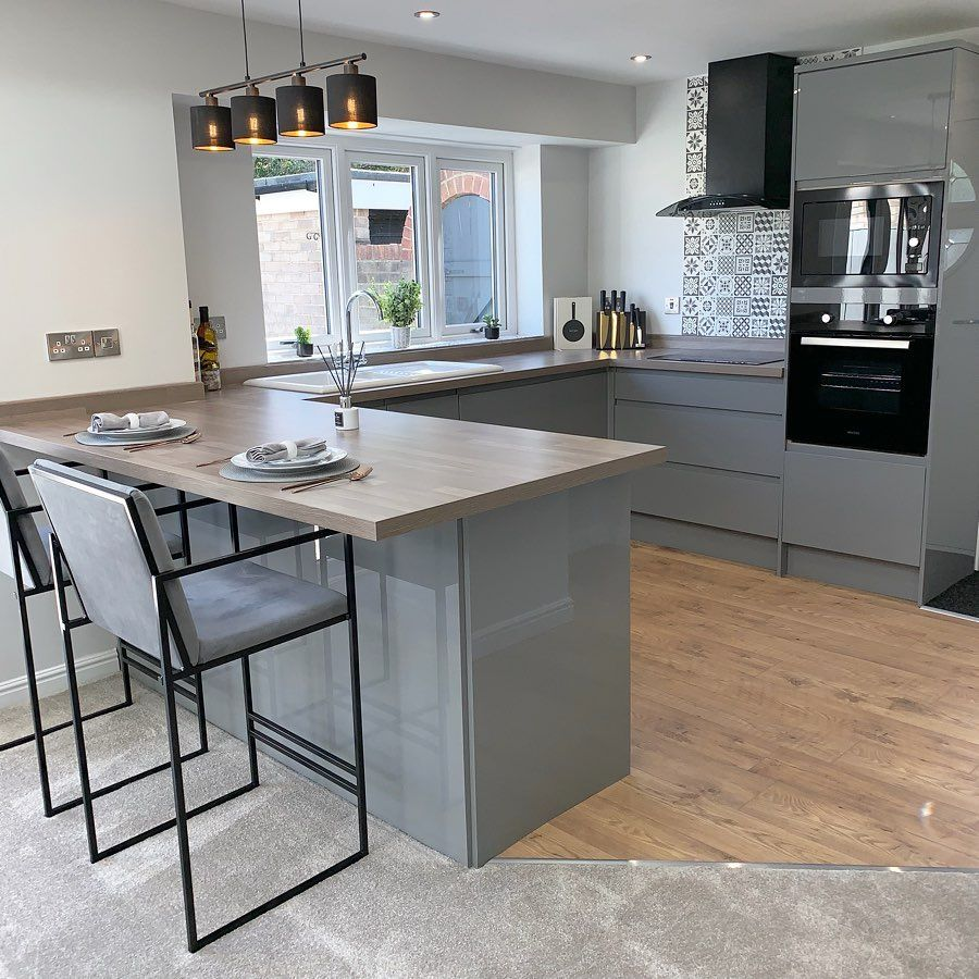 We love this Gloss Grey kitchen. Add a breakfast bar for a