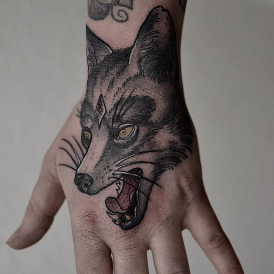 wolf tattoo meaning wolf tattoo designs wolf tattoos wolf tattoo design and tattoo. Black Bedroom Furniture Sets. Home Design Ideas