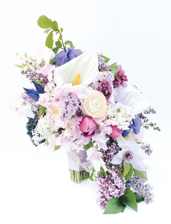 bouquet with white calla lilies, lavender and white lilac, iris, blush ranunculus, lavender sweet peas, and white clematis   Katie Stoops #wedding