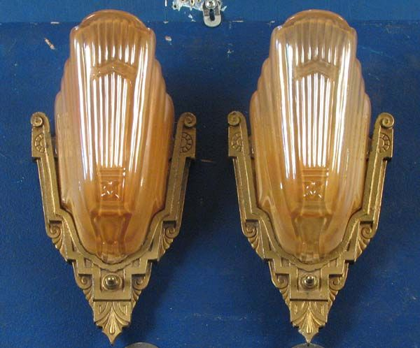 Art deco sconces and chandeliers like the ones that were on the wall