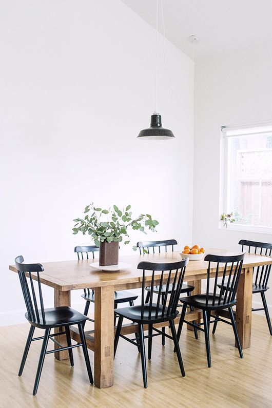 Airy Dining Room Wood Farmhouse Table Black Chairs