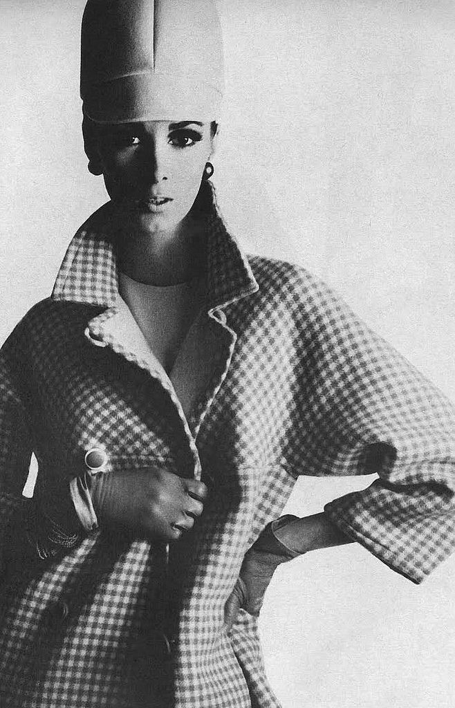 Wilhelmina is wearing a double-faced wool coat of fawn and ivory checks by Dan Millstein, photo by Bert Stern for Vogue 1966