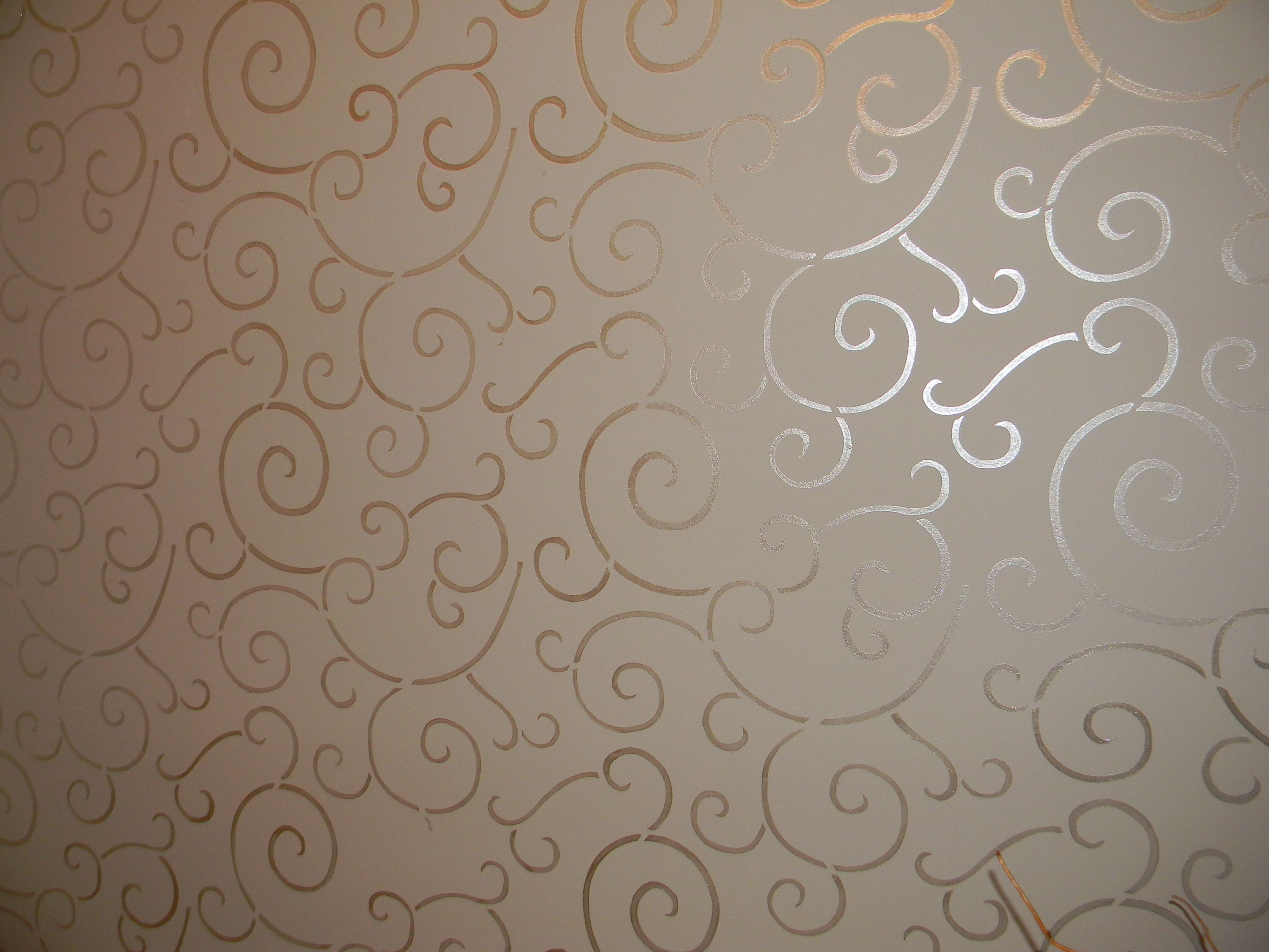 Wall stenciled with metallic paint gives the look of - Metallic paint wall designs ...