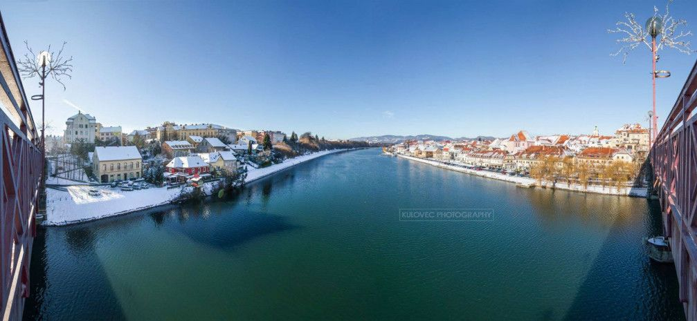 River Drava River winds through the city of Maribor, Slovenia