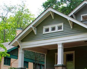 Green bungalow with brackets under the eaves 1920s for Craftsman gable brackets