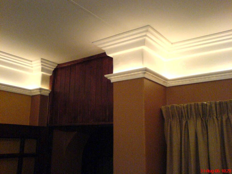 Narrow Tray Ceiling Illuminated With Rope Lighting And Designed With